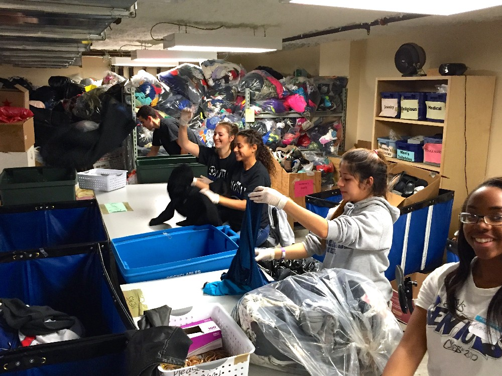 JD, Natalie, Cierra, Nancy & LaDiamond sorting donated clothing